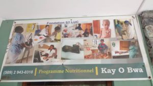 Christmas Party from Kay-O-Bois malnutrition program - Sign